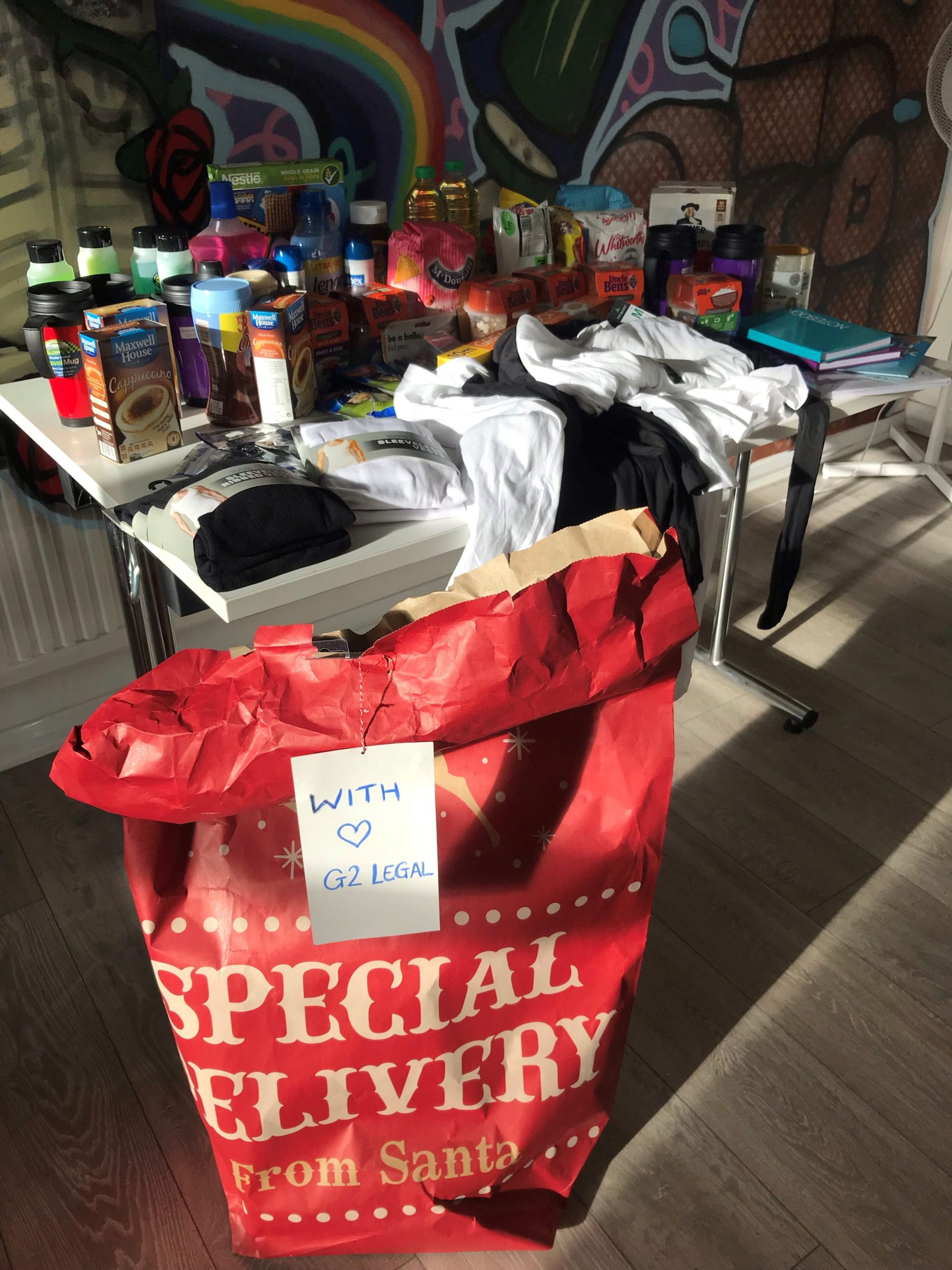 A table of donated goods in the day centre studio.